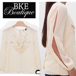 BKE cream slit long sleeves sequins blouse size L